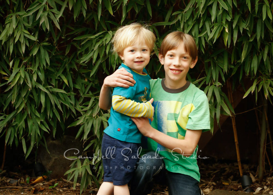Portrait of boys on bamboo background by child photographers at Campbell Salgado Studio in Portland, Oregon.