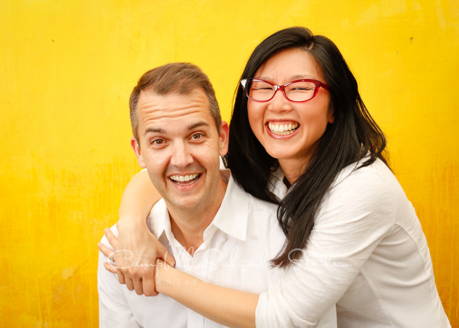 Portrait of couple on liquid sunshine background by family photographers at Campbell Salgado Studio in Portland, Oregon.