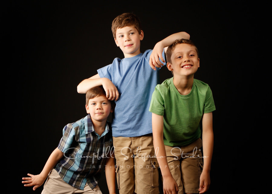 Portrait of boys on black background by family photographers at Campbell Salgado Studio in Portland, Oregon.
