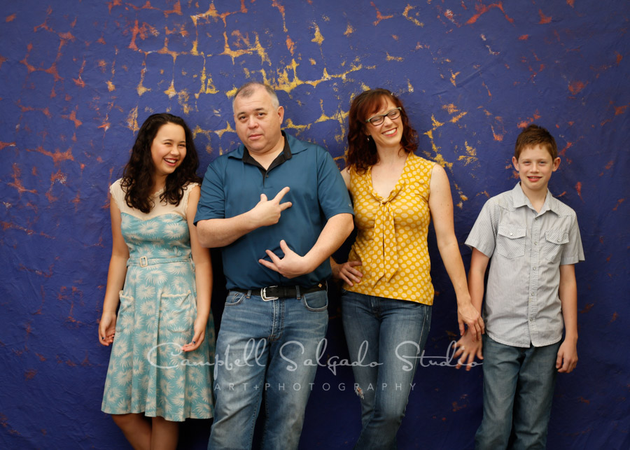 Portrait of family on the Frida background by family photographers at Campbell Salgado Studio in Portland, Oregon.