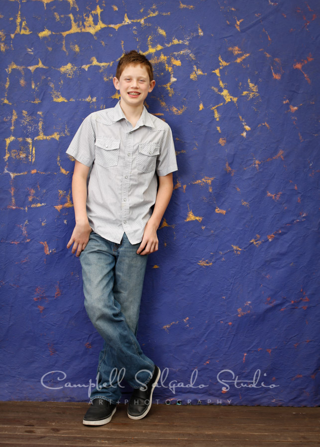 Portrait of boy on the Frida background by children's photographers at Campbell Salgado Studio in Portland, Oregon.