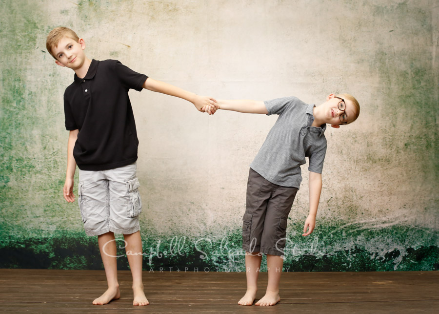 Portrait of boys on abandoned concrete background by family photographers at Campbell Salgado Studio in Portland, Oregon.
