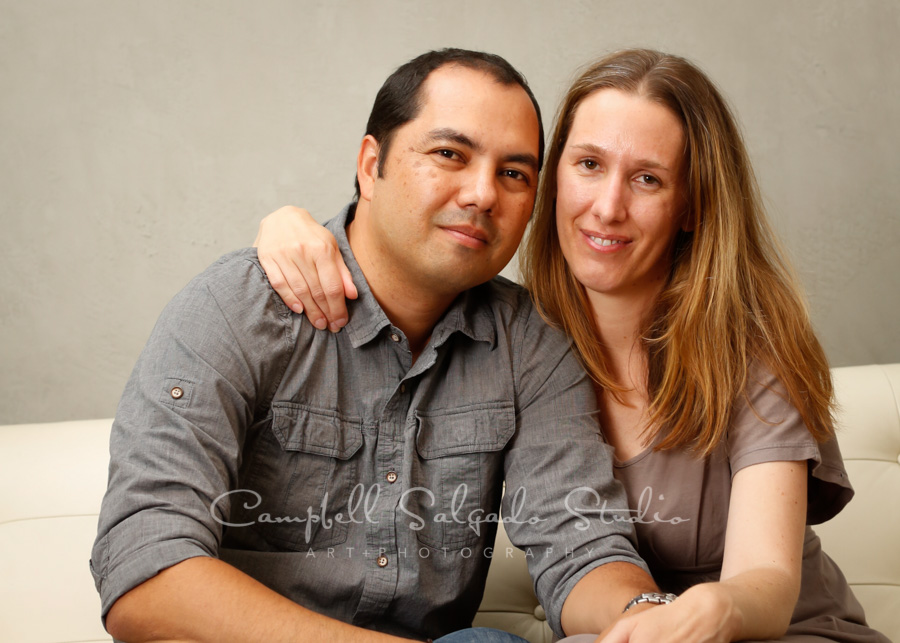 Portrait ofcouple on modern grey background by family photographers at Campbell Salgado Studio in Portland, Oregon.