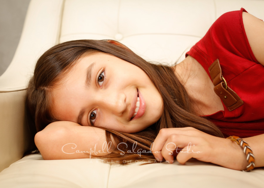 Portrait of girl on modern grey background by family photographers at Campbell Salgado Studio in Portland, Oregon.