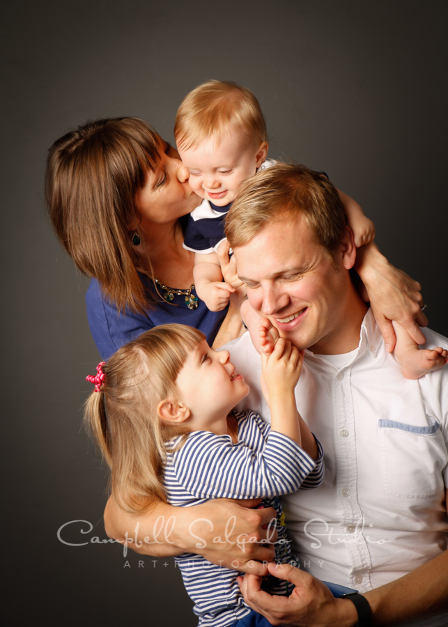 Portrait of family on gray background by family photographers at Campbell Salgado Studio in Portland, Oregon.