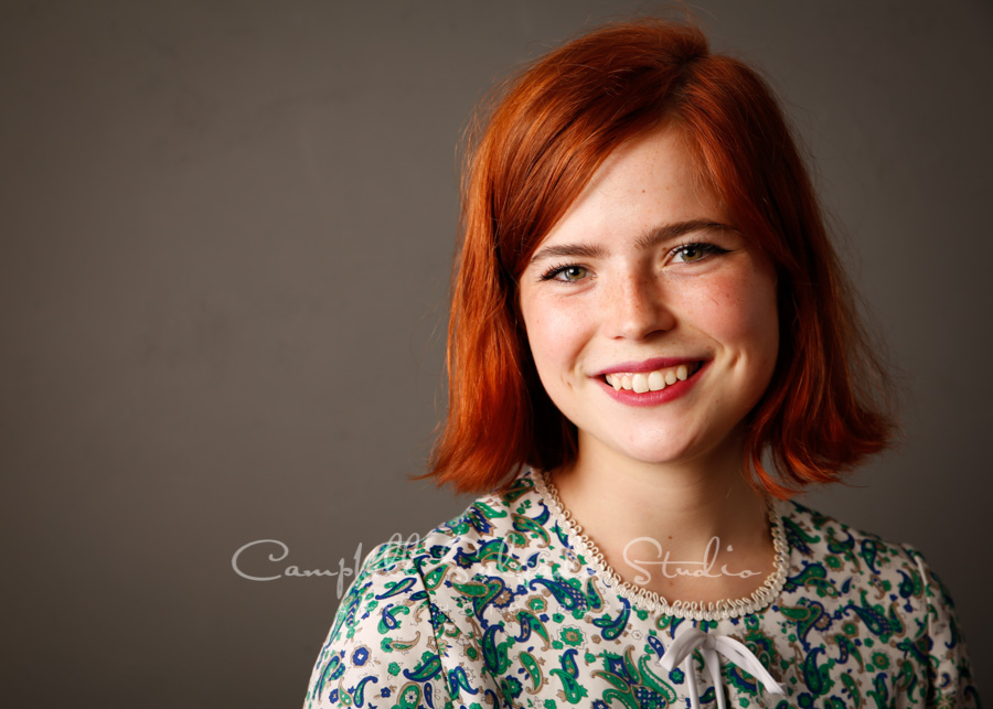 Portrait of teen on gray background by family photographers at Campbell Salgado Studio in Portland, Oregon.