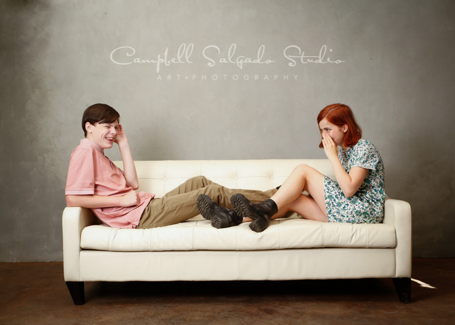 Portrait of teens on modern gray background by family photographers at Campbell Salgado Studio in Portland, Oregon.