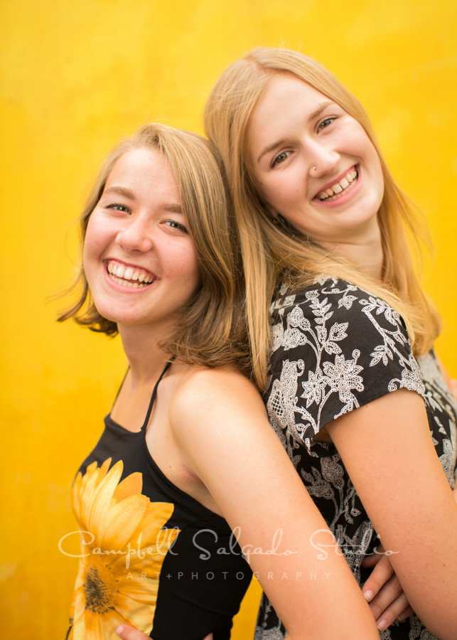 Portrait of sisters on liquid sunshine background by teen photographers at Campbell Salgado Studio in Portland, Oregon.