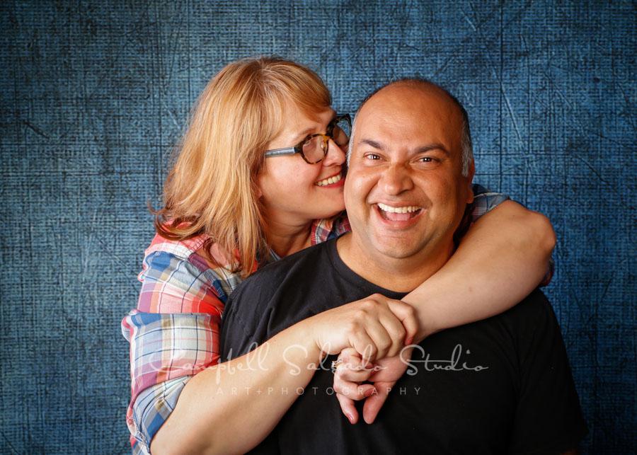 Portrait of couple on denim background by couples photographers at Campbell Salgado Studio in Portland, Oregon.
