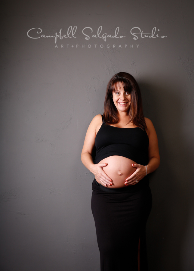 Maternity portrait of woman on gray background by maternity photographers at Campbell Salgado Studio in Portland, Oregon.