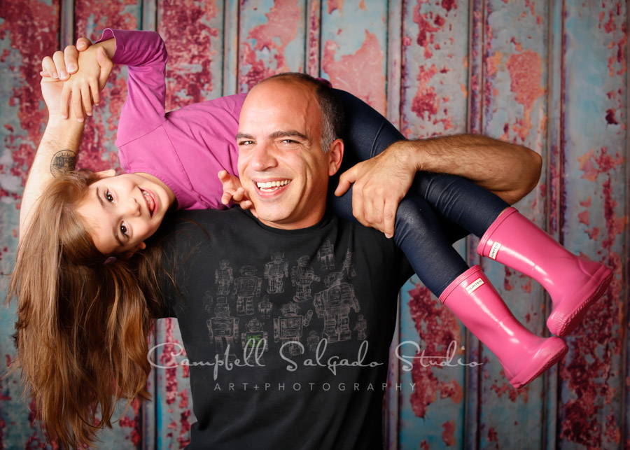 Portrait of father and daughter on Italian rust backgorund by family photographers at Campbell Salgado Studio in Portland, Oregon.