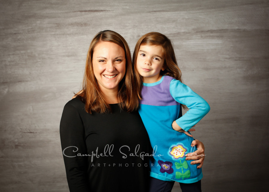 Portrait of mother and daughter on graphite background by family photographers at Campbell Salgado Studio in Portland, Oregon.