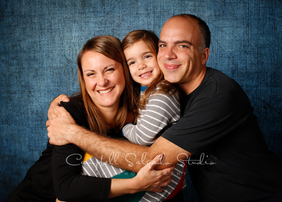 Portrait of family on denim background by family photographers at Campbell Salgado Studio in Portland, Oregon.