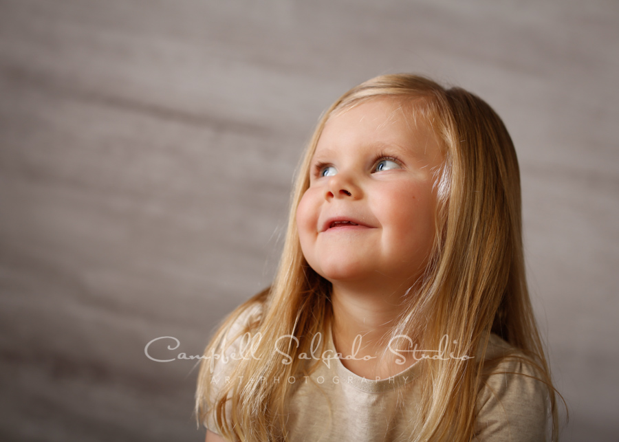 Portrait of child on graphite background by child's photographers at Campbell Salgado Studio in Portland, Oregon.
