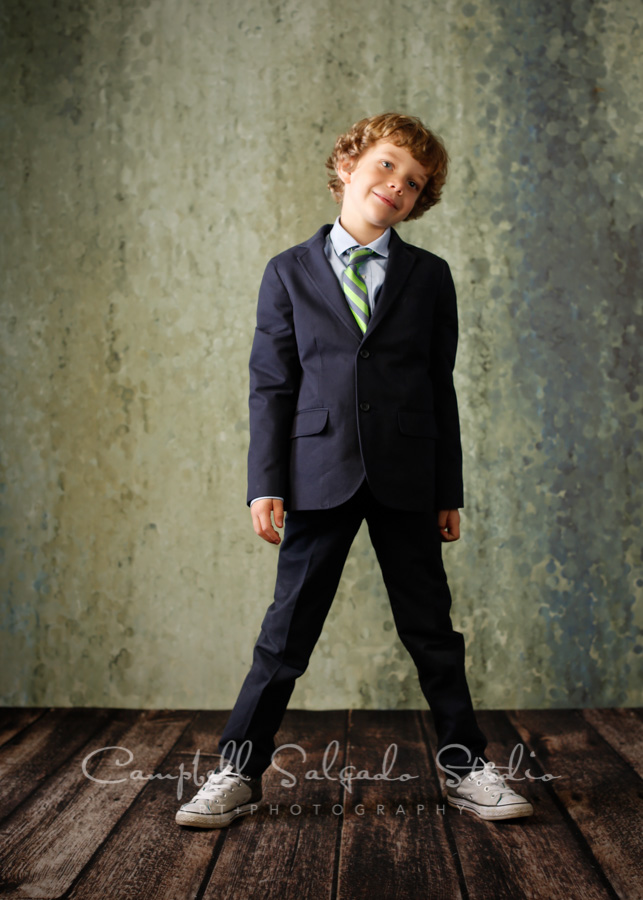 Portrait of child on rain dance background by child's photographers at Campbell Salgado Studio in Portland, Oregon.