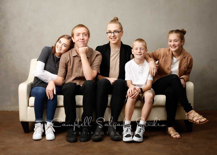 Portrait of siblings on modern grey background by family photographers at Campbell Salgado Studio in Portland, Oregon.