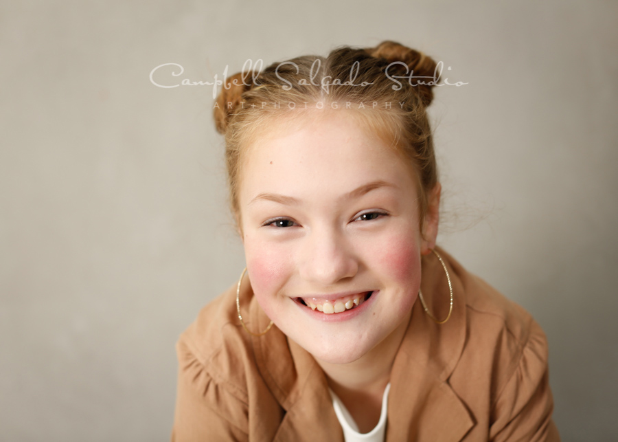 Portrait of girl on modern grey background by child photographers at Campbell Salgado Studio in Portland, Oregon.