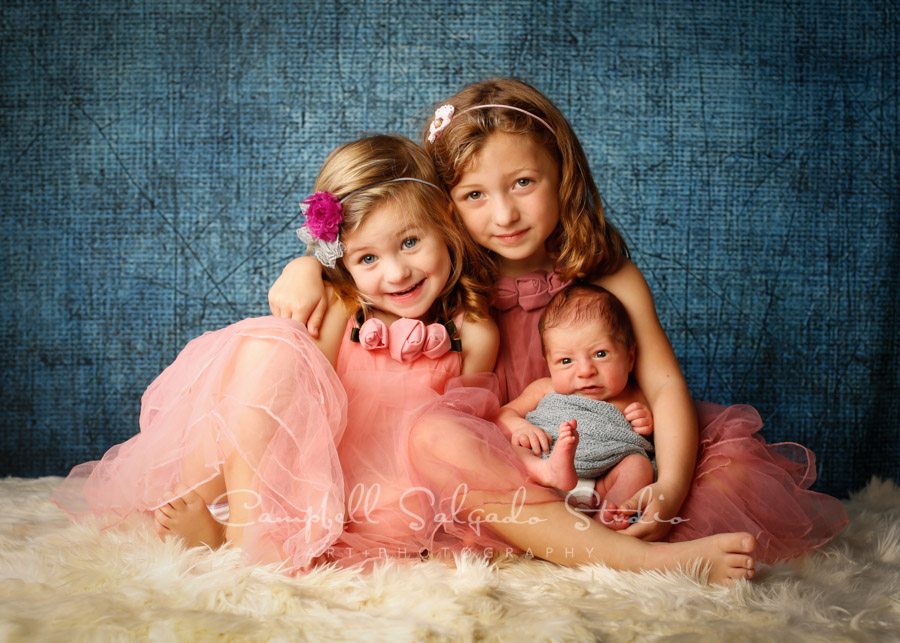 Portrait of children on denim background by family photographers at Campbell Salgado Studio in Portland, Oregon.