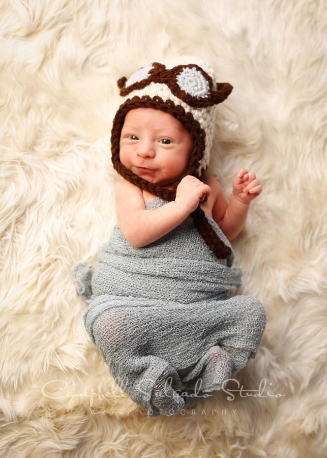 Portrait of newborn on alpaca background by newborn photographers at Campbell Salgado Studio in Portland, Oregon.