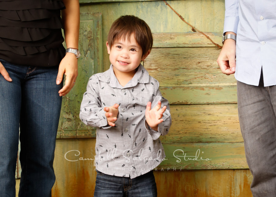 Portrait of boy on vintage green doors background by family photographers at Campbell Salgado Studio in Portland, Oregon.