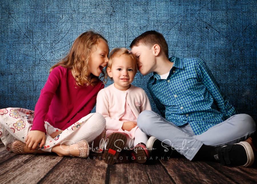 Portrait of children on denim background by children's photographers at Campbell Salgado Studio in Portland, Oregon.