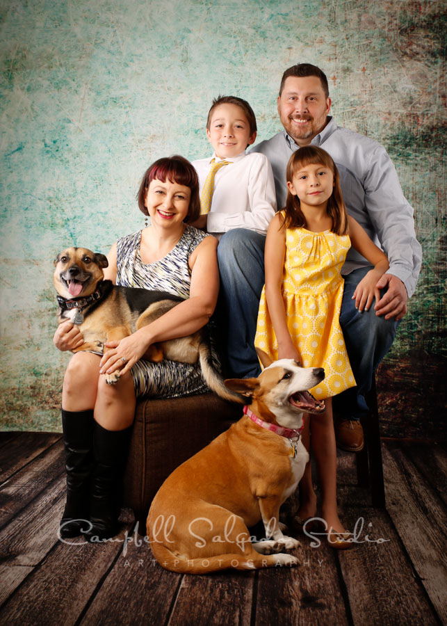 Portrait of family on weathered green background by family photographers at Campbell Salgado Studio in Portland, Oregon.