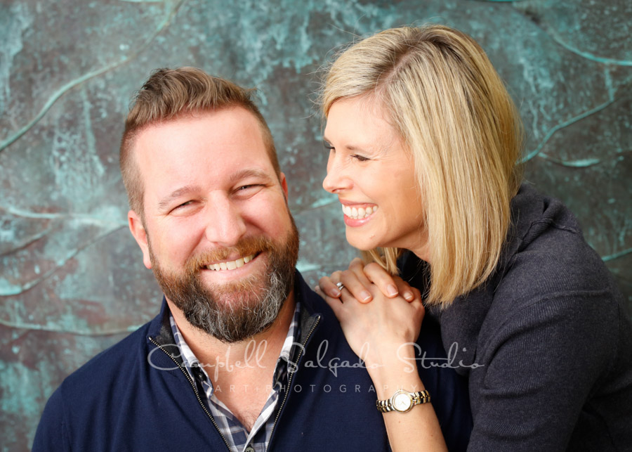 Portrait of couple on copper wave background by couples photographers at Campbell Salgado Studio in Portland, Oregon.