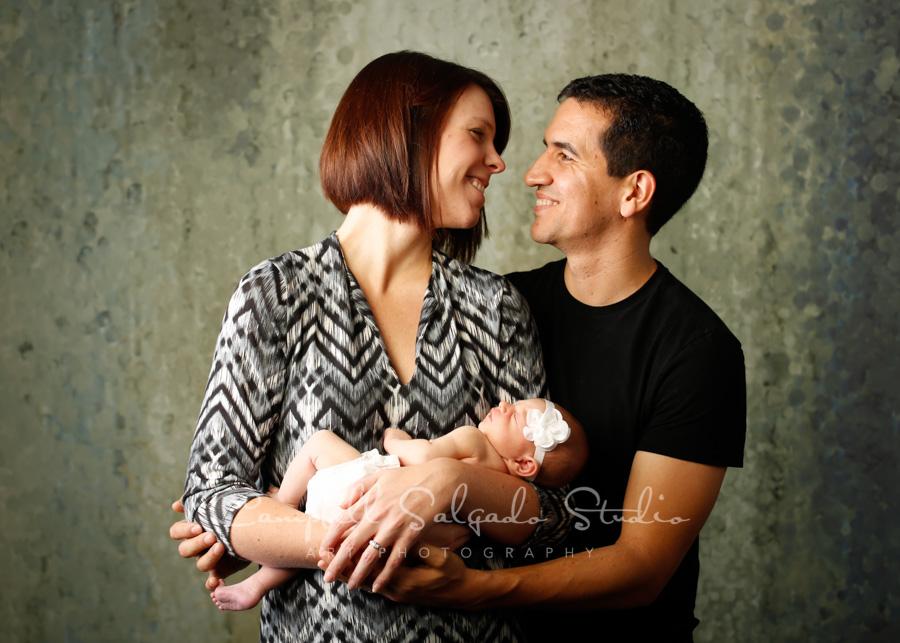 Portrait of family on rain dnace background by newborn photographers at Campbell Salgado Studio in Portland, Oregon.