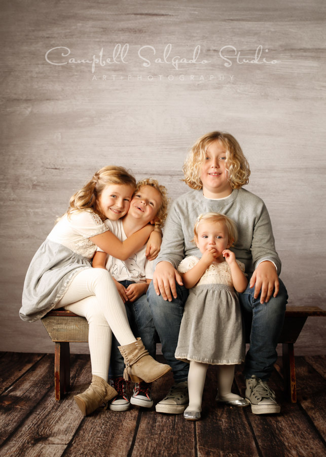 Portrait of children on graphite background by family photographers at Campbell Salgado Studio in Portland, Oregon.