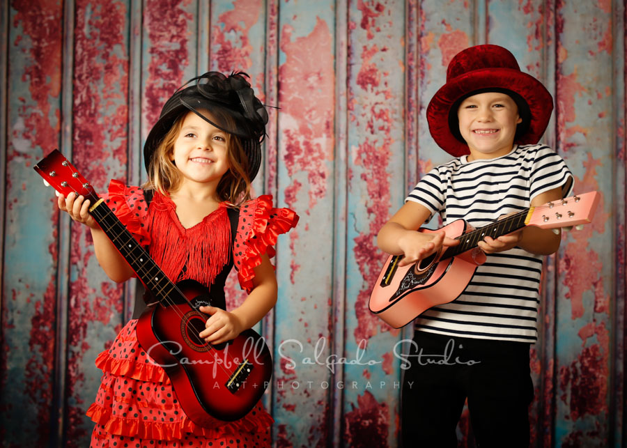 Portrait of children on Italian rust background by child photographers at Campbell Salgado Studio in Portland, Oregon.