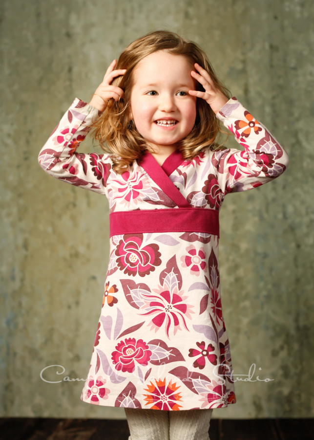 Portrait of child on rain dance background by child photographers at Campbell Salgado Studio in Portland, Oregon.