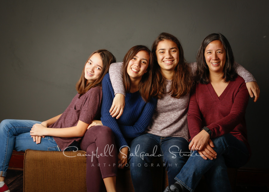 Portrait of family on grey background by family photographers at Campbell Salgado Studio in Portland, Oregon.
