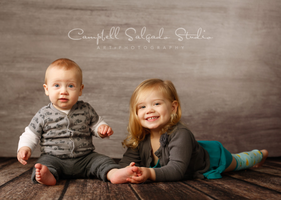 Portrait of children on graphite background by child photographers at Campbell Salgado Studio in Portland, Oregon.