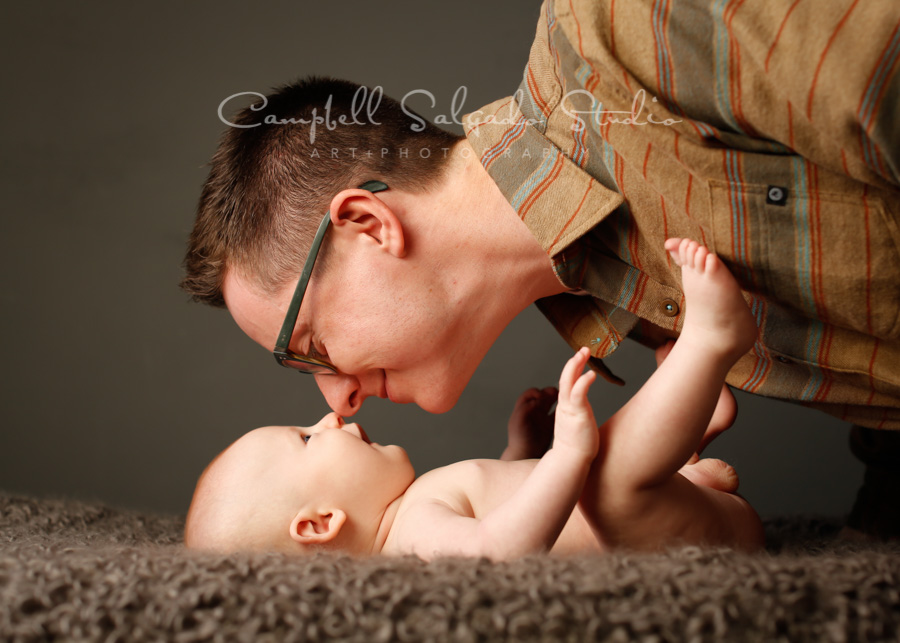 Portrait of father and son on gray background by family photographers at Campbell Salgado Studio in Portland, Oregon.