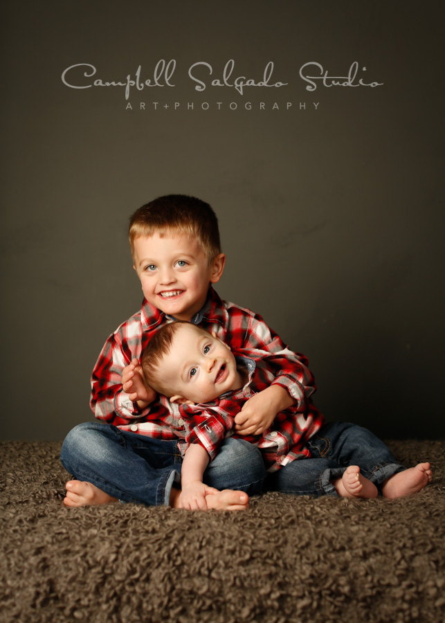Portrait of boys on gray background by children's photographers at Campbell Salgado Studio in Portland, Oregon.