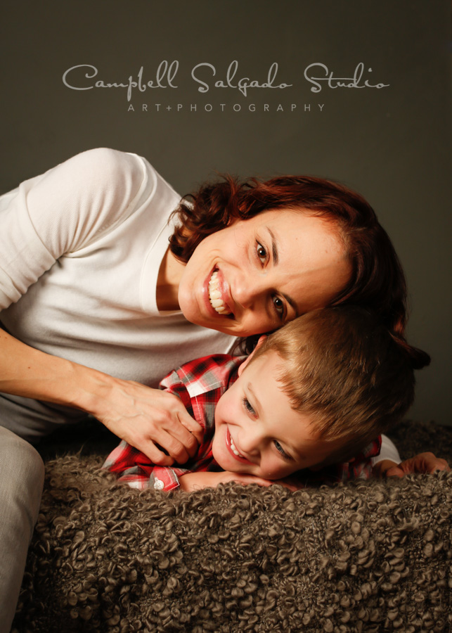 Portrait of mother and son on gray background by family photographers at Campbell Salgado Studio in Portland, Oregon.