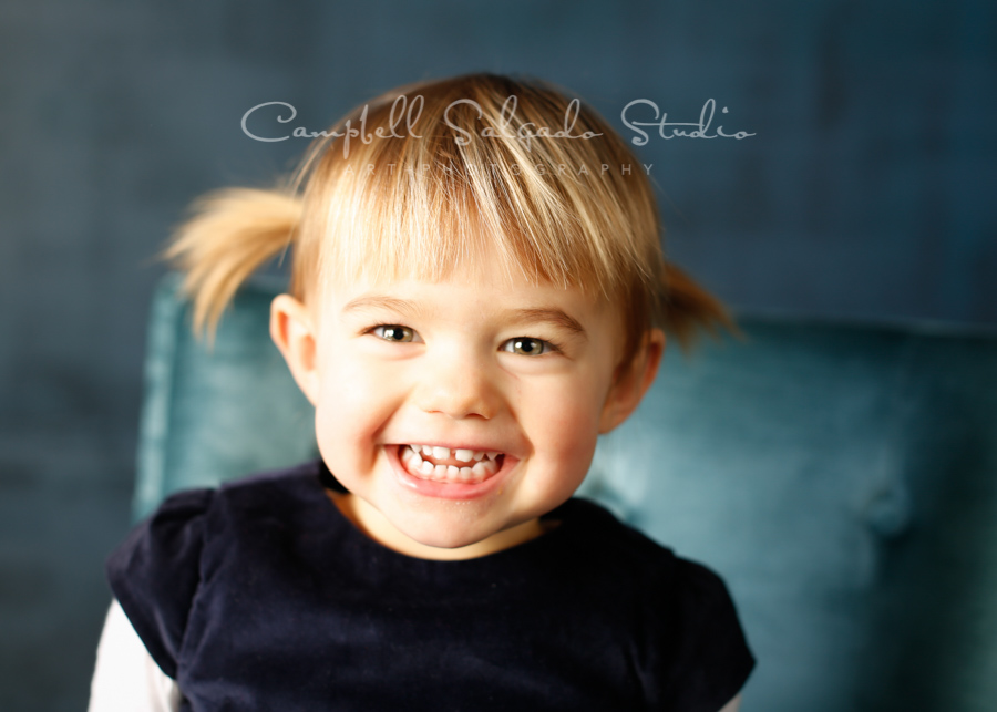 Portrait of child on deep ocean background by child photographers at Campbell Salgado Studio in Portland, Oregon.