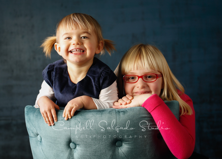 Portrait of children on deep ocean background by child photographers at Campbell Salgado Studio in Portland, Oregon.