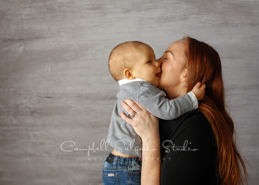 Portrait of mother and son on graphite background by family photographers at Campbell Salgado Studio in Portland, Oregon.