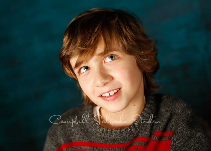 Portrait of boy on deep ocean background by child photographers at Campbell Salgado Studio in Portland, Oregon.