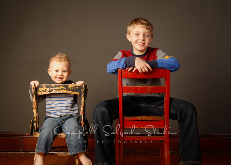Portrait of children on gray background by childrens photographers at Campbell Salgado Studio in Portland, Oregon.