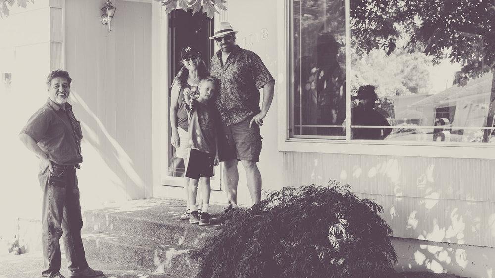 Portland Realtor® Francisco Salgado with clients in front of their new home, Portland, Oregon.