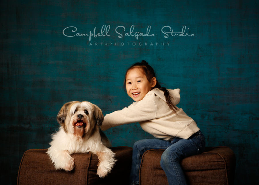 Portrait of boy and dog on deep ocean background by pet photographers at Campbell Salgado Studio in Portland, Oregon.