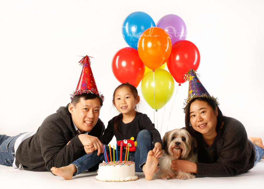 Portrait of family on white background by family photographers at Campbell Salgado Studio in Portland, Oregon.