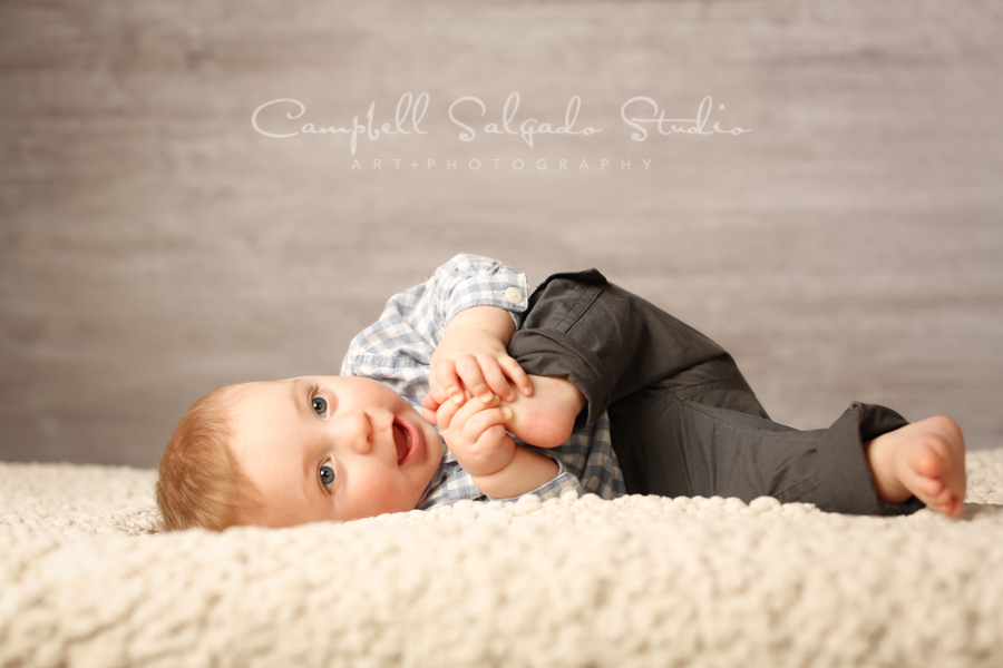Portrait of baby on graphite background by baby photographers at Campbell Salgado Studio in Portland, Oregon.