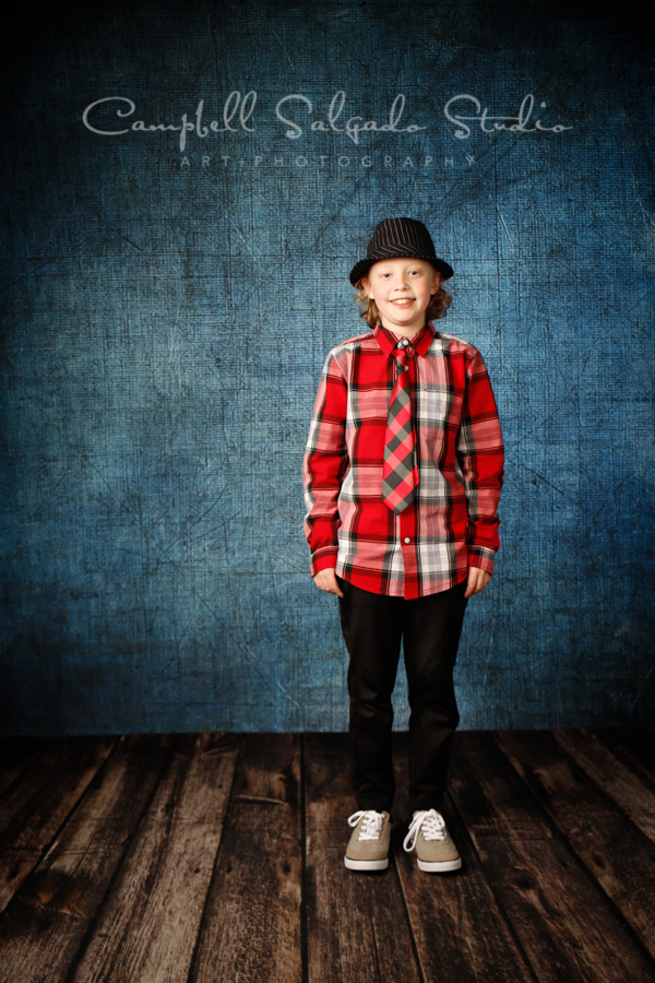 Portrait of boy on denim background by child photographers at Campbell Salgado Studio in Portland, Oregon.