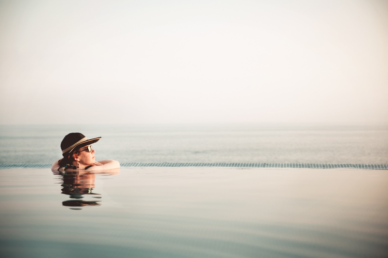 Kim watching the sunset at the infinity pool.