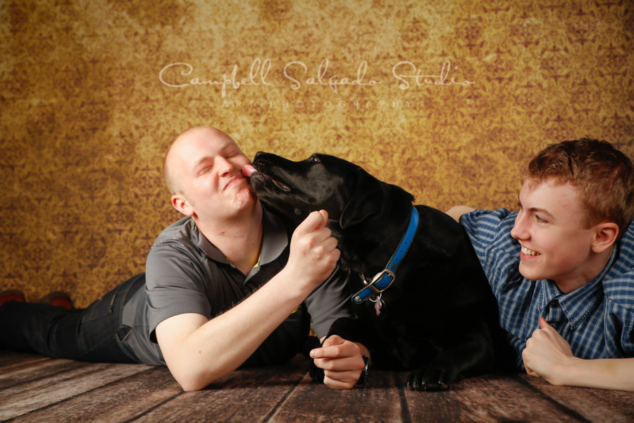 Portrait of brothers and dog on amber light background by family photographers at Campbell Salgado Studio in Portland, Oregon.