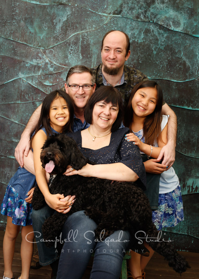 Portrait of family on ocean weave background by family photographers at Campbell Salgado Studio in Portland, Oregon.