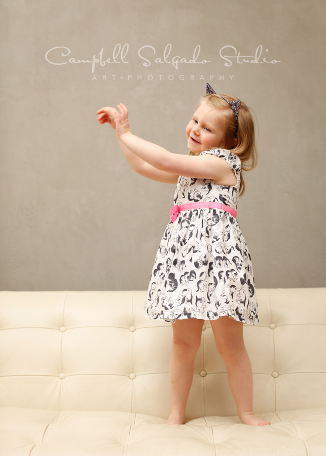 Portrait of child on modern gray background by child photographers at Campbell Salgado Studio in Portland, Oregon.